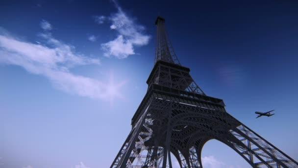 letadlo letící nad Eiffelova věž