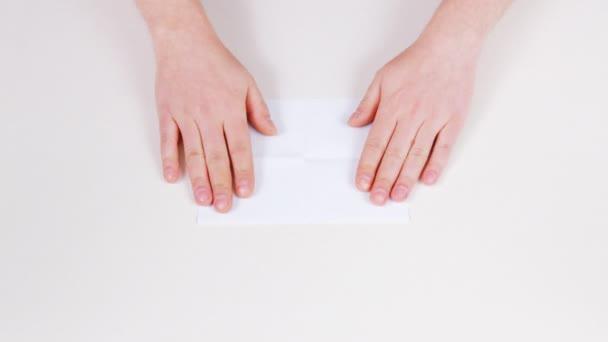 Folding a sheet of paper