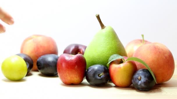 Woman selects fresh fruit.