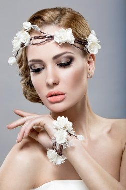 A beautiful woman with flowers on her head