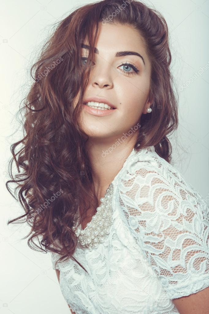 Beautiful smiling girl with natural makeup and loose hair. Picture taken in  the studio on a white background. — Photo by kobrin-photo 8e171cce5