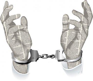 handcuffed hands of newspaper columns