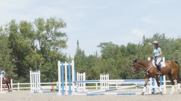 Equestrienne preparing to jump