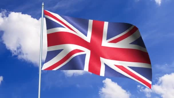 Britain flag waving in the wind against a blue sky