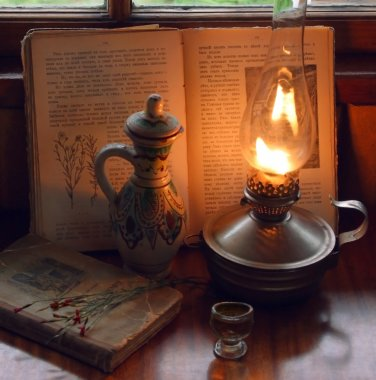 Stillife with oil lamp and an ancient book of recipes