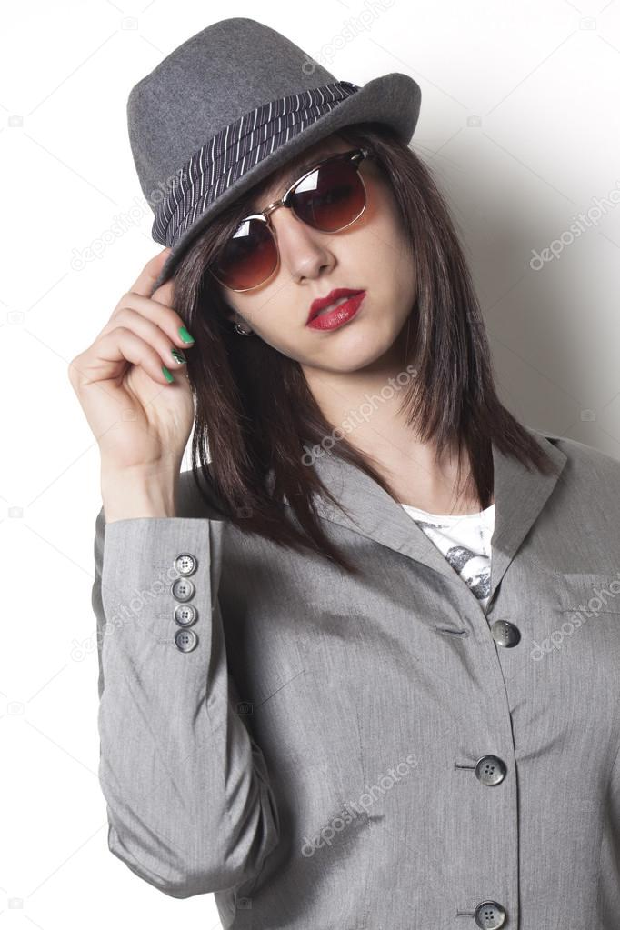 Beautiful gangster woman wearing a hat and suit jacket and looking — Photo  by patronestaff 10e91406f7b