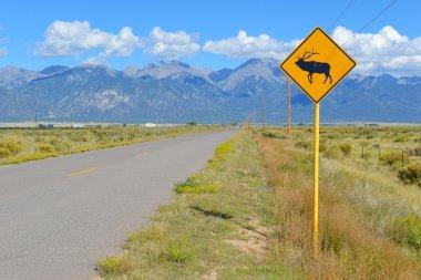 Elk-Deer Crossing Sign on the road