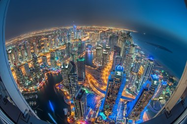 Dubai Marina at Night. Tallest Buildings of Marina at Blue Hour taken from a rooftop. City of lights. Dubai, United Arab Emirates