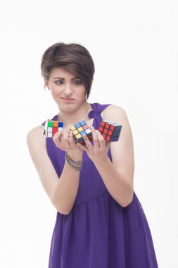 Emotional woman  keeping a puzzle cubes