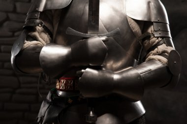 Medieval knight in armor holding a sword