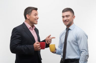 Business people discuss something during coffee break
