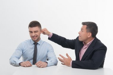 Senior manager chief pulling his employee ear