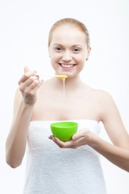 Woman preparing  homemade  facial mask of honey