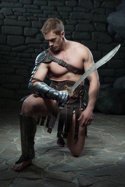 Gladiator with sword kneeling