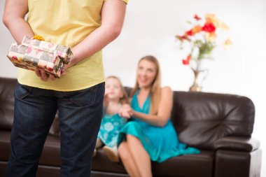 Father giving present to beautiful daughter and mother