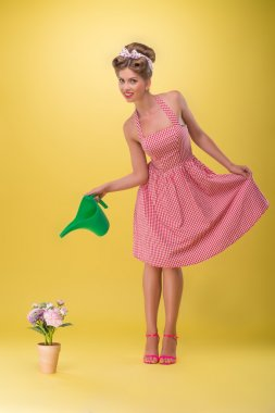 Beautiful sexy girl with pretty smile wearing dress in pinup sty