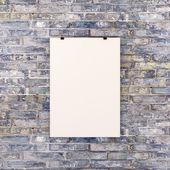 bianco bianco poster sul muro di mattoni