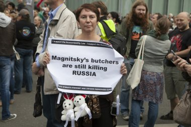 Woman holding a poster with inscription Magnitsky's butcher are still killing