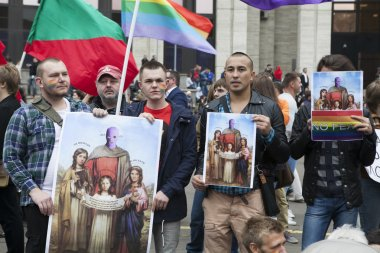 Protestant holds poster and icons with image of Pussy Riot