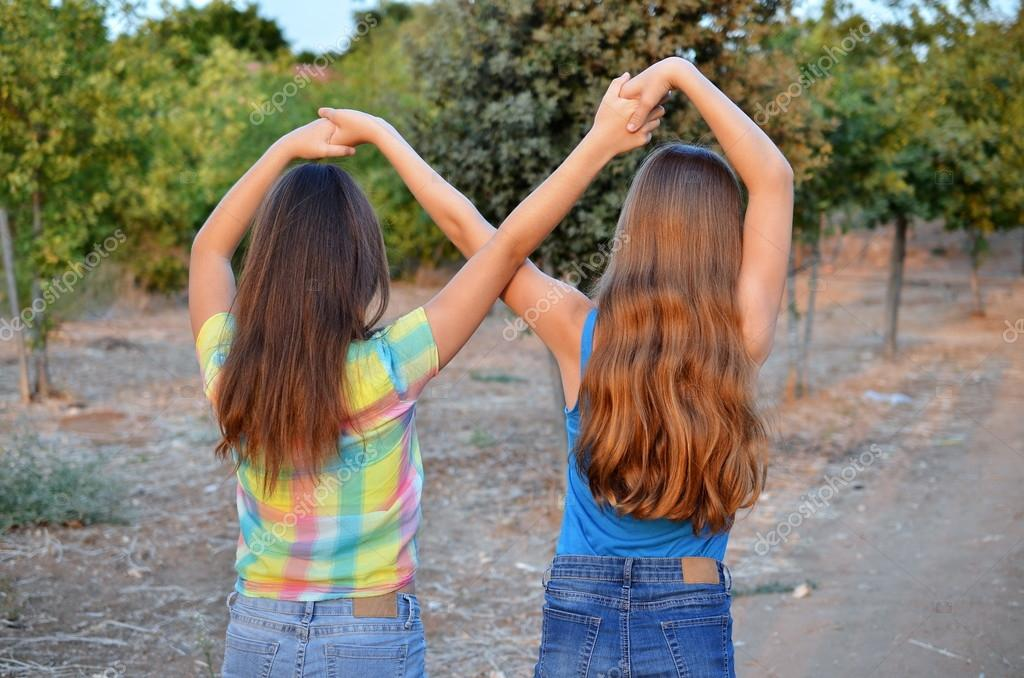 Two best friend girls making a forever sign — Stock Photo © dnaveh ...