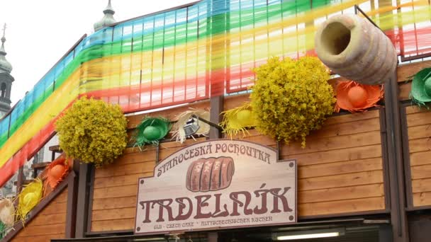 Easter markets - shop with Trdelnik (cake) - with Easter decorations. Old Town Square in Prague.