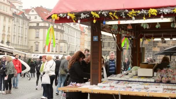 Easter markets - shops with people and square in front of Astronomical Clock. Old Town Square in Prague.