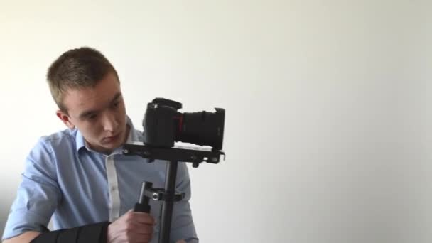 Man films with professional camera (steadicam)