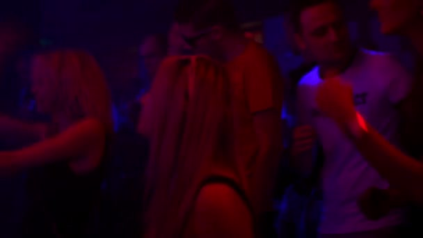 People dancing at a party (disco) - stage lights