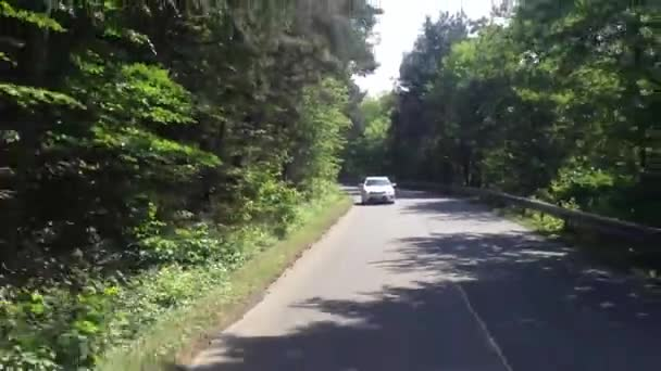 Car travels on a road in the countryside(nature) - with other cars