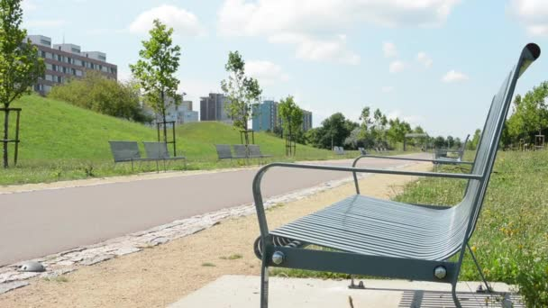 Benches in the park with housing estate (development)