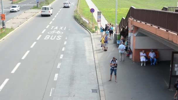 Bus stop - people wait for the bus