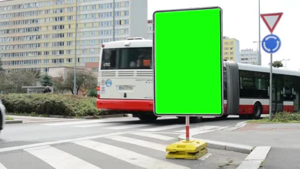 Traffic signs - green screen - passing bus and cars - housing estate with trees in backgound
