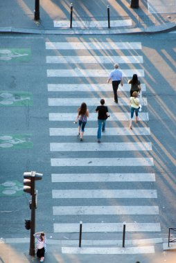 People crossing the street on zebra crossing
