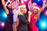 Happy people in Santa hats