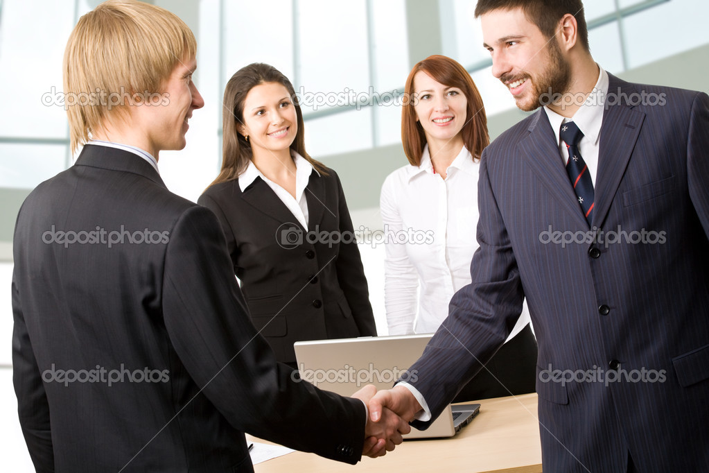 Business people greeting each stock photo chagin 44751071 business people greeting each other before meeting with two businesswomen on background photo by chagin m4hsunfo