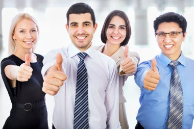 Business people showing thumbs up sign