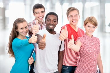 Students show thumbs up