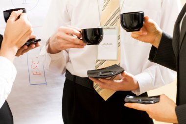 Businesspeople with coffee cups