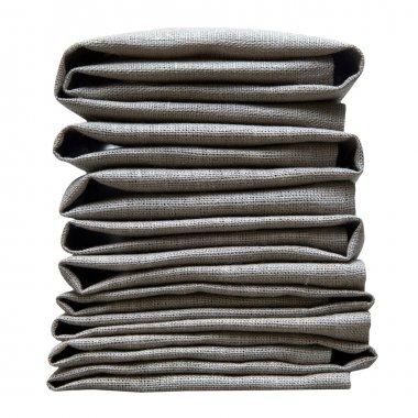 Linen napkins folded pile isolated on white background.