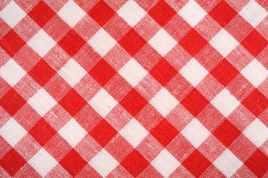 Red and white plaid fabric. Linen red checkered. Background and texture.