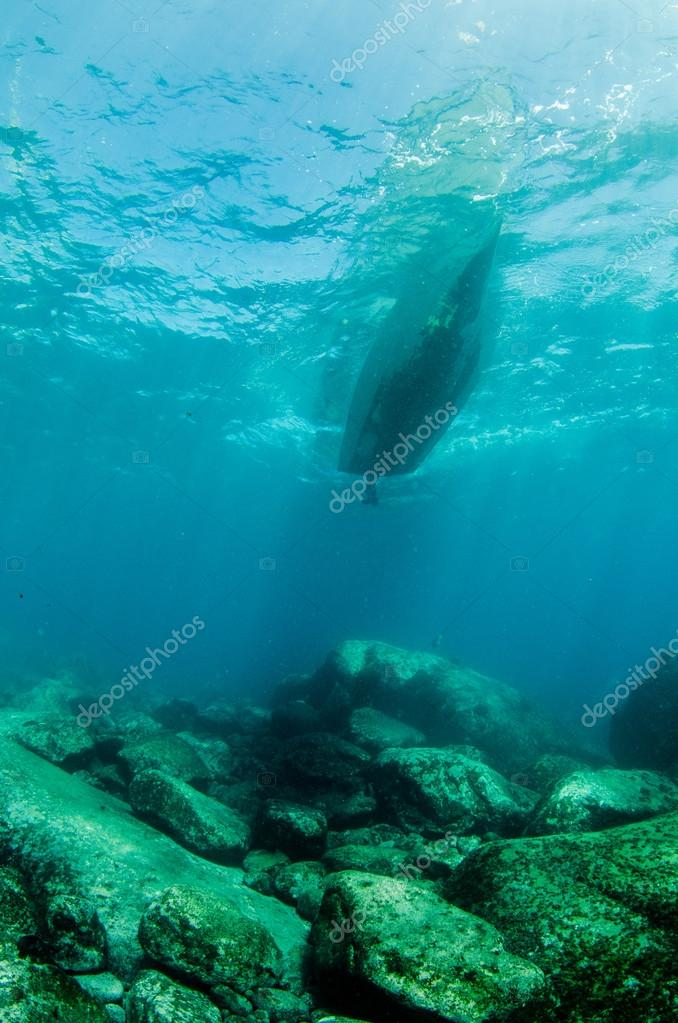 Boat from underwater reef