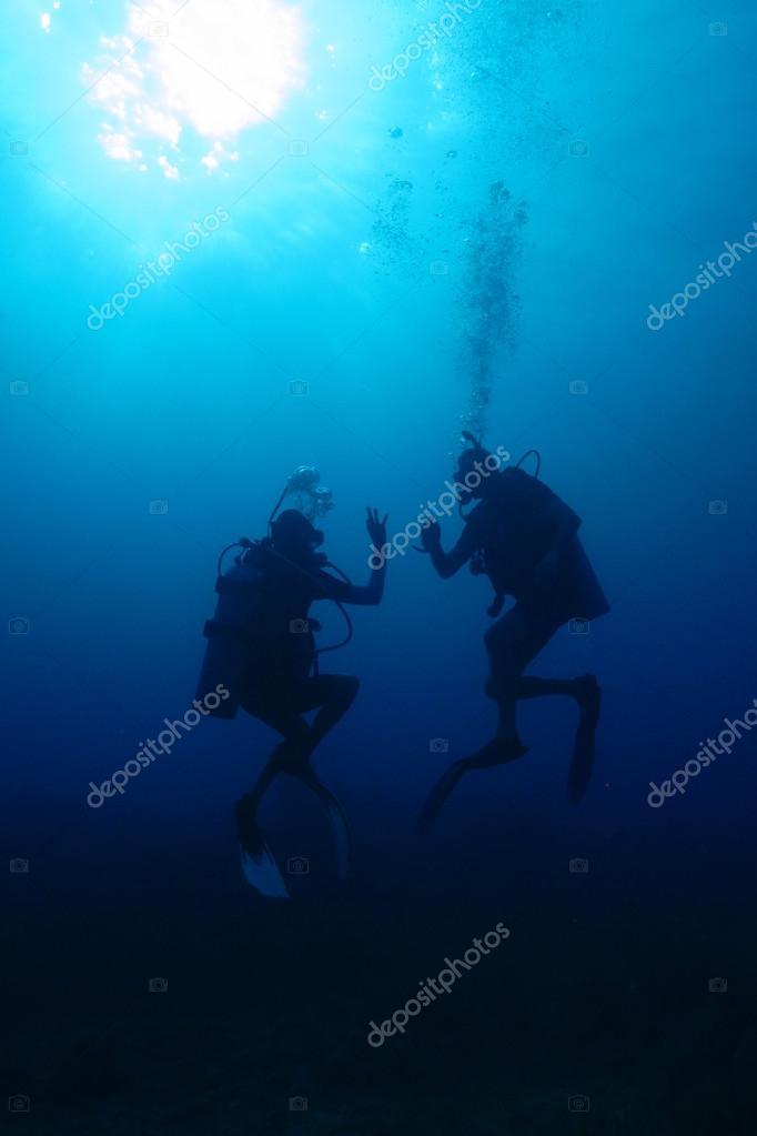 Divers in caribbean sea