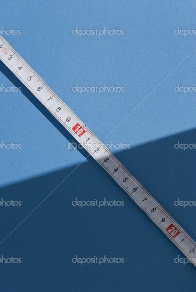 Tape measure stock photo bogdandreava 46771865 tape measure on light blue background photo by bogdandreava aloadofball Images