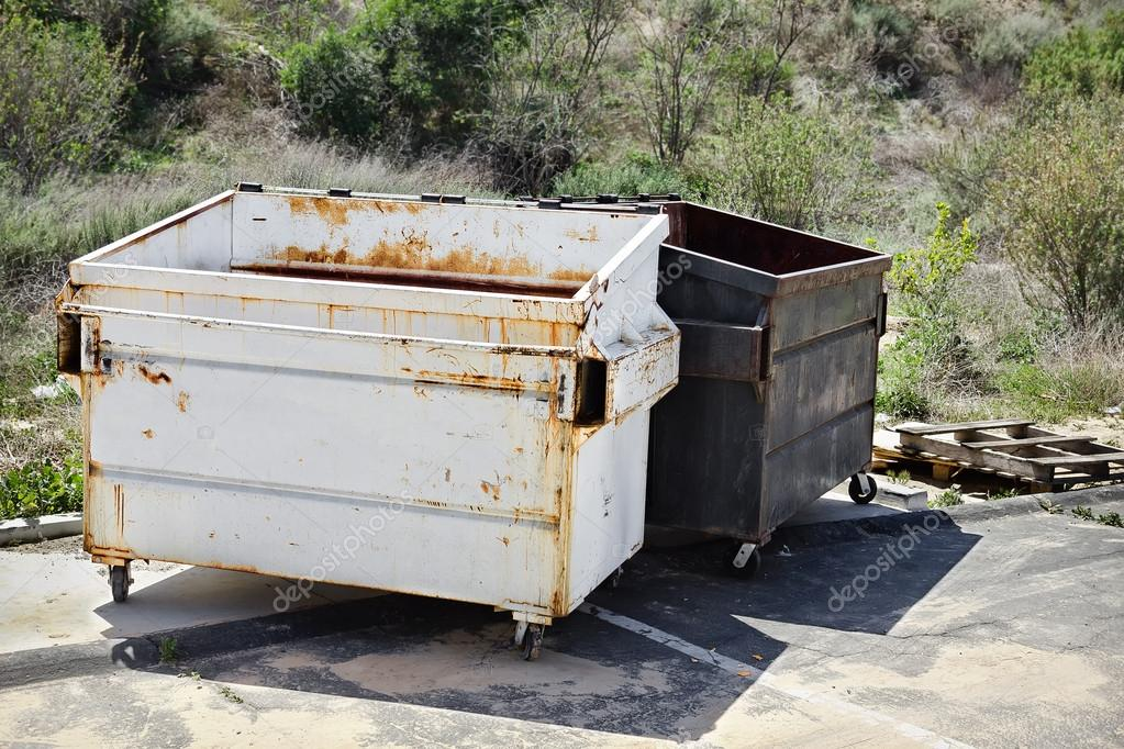 Two Trash Dumpsters