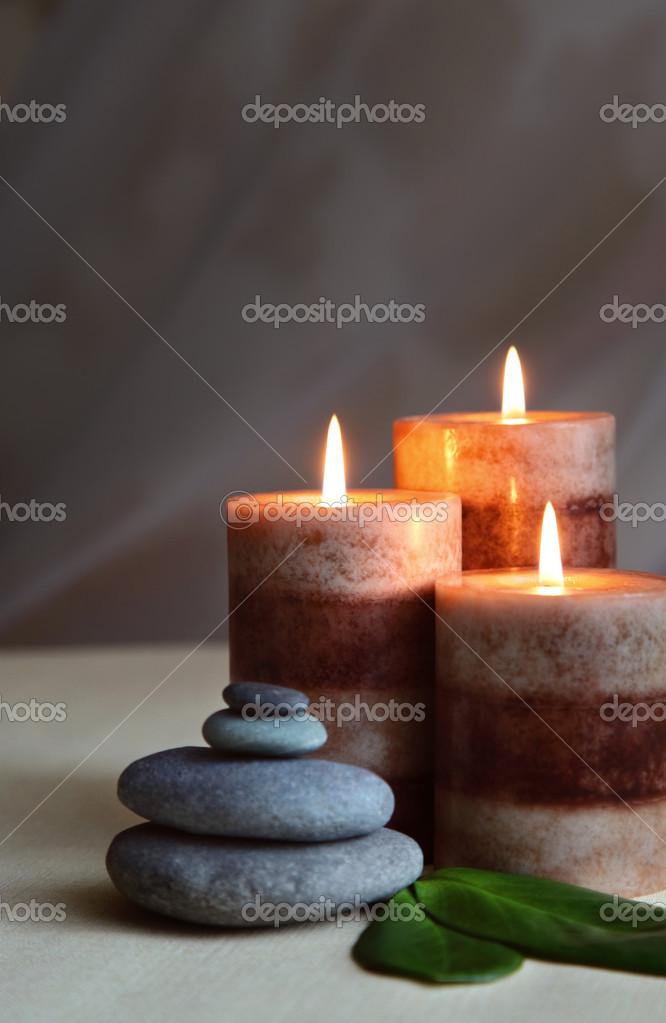 candles and stones stock photo svetlana nsk 45664047