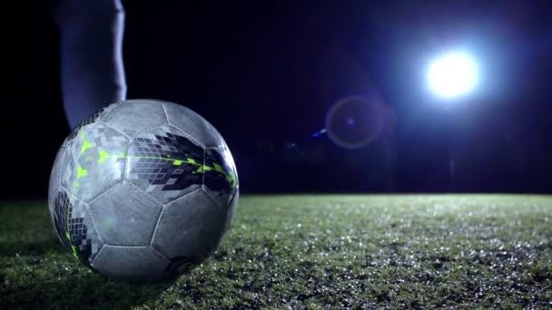 Soccer player kicks a ball