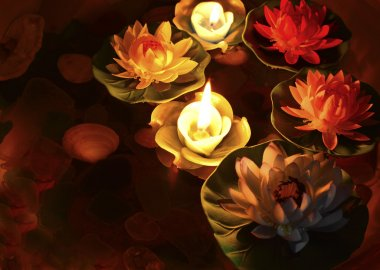 Lotus flower and burning candles