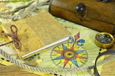 Sea map with compass and notepad