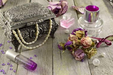 Vintage still life with lilac fragrances