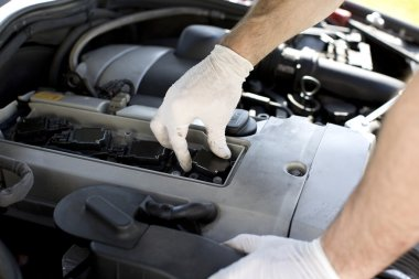 Spark plugs being replaced during a car service